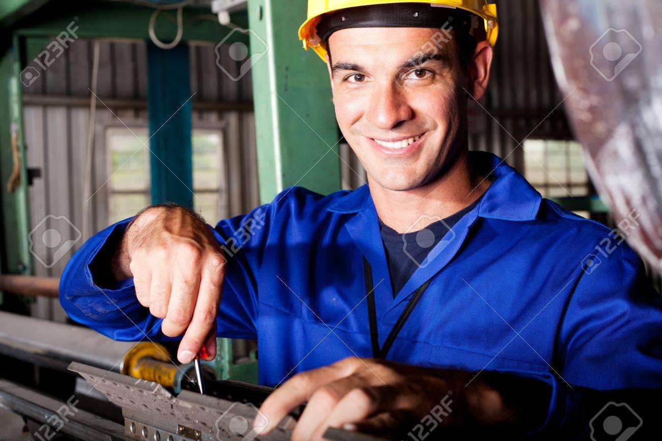 Happy Caucasian Mechanic Repairing Heavy Industry Machine – Machine Mechanic