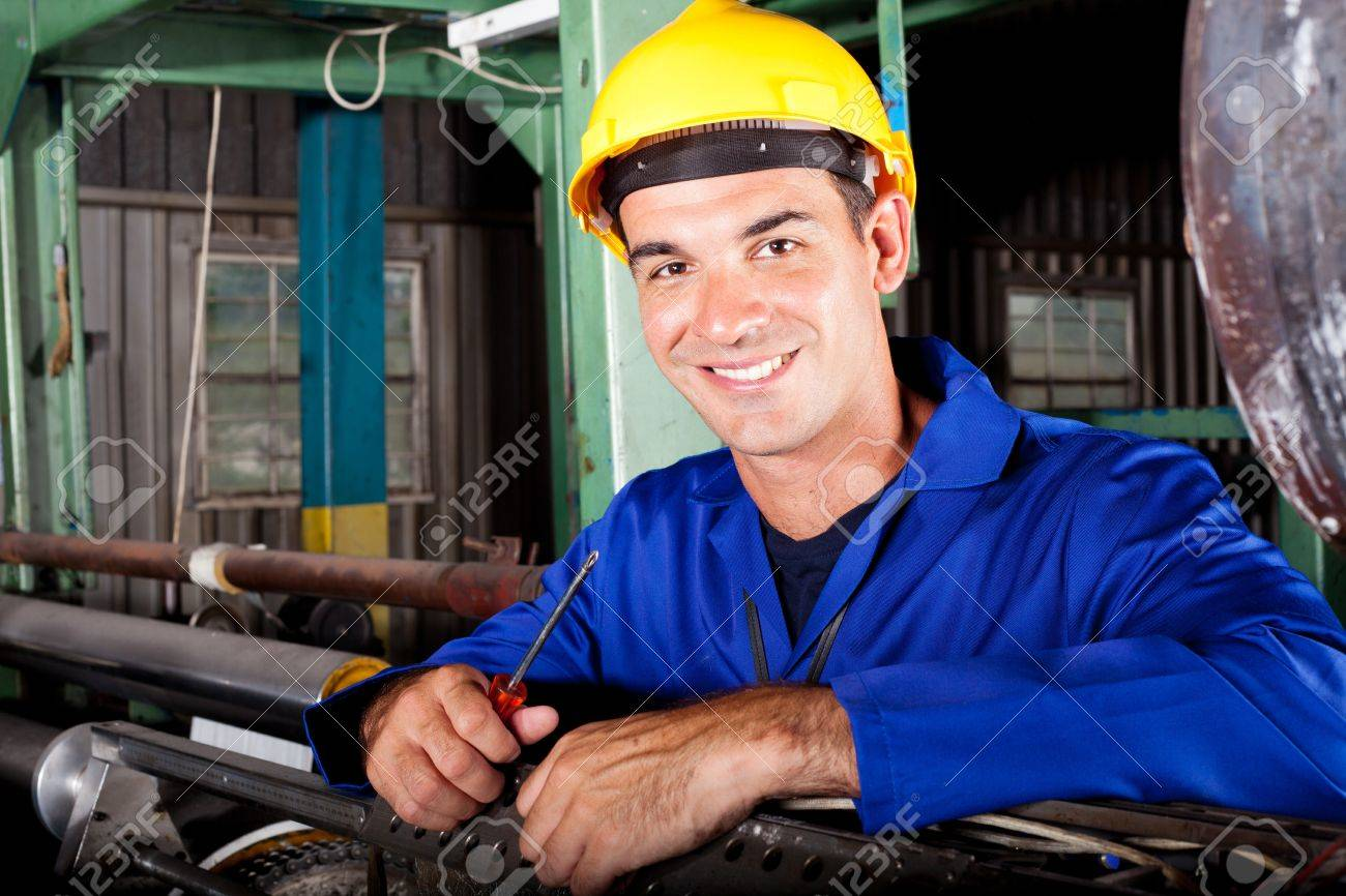 Happy Male Industrial Mechanic At Work Stock Photo, Picture And ...