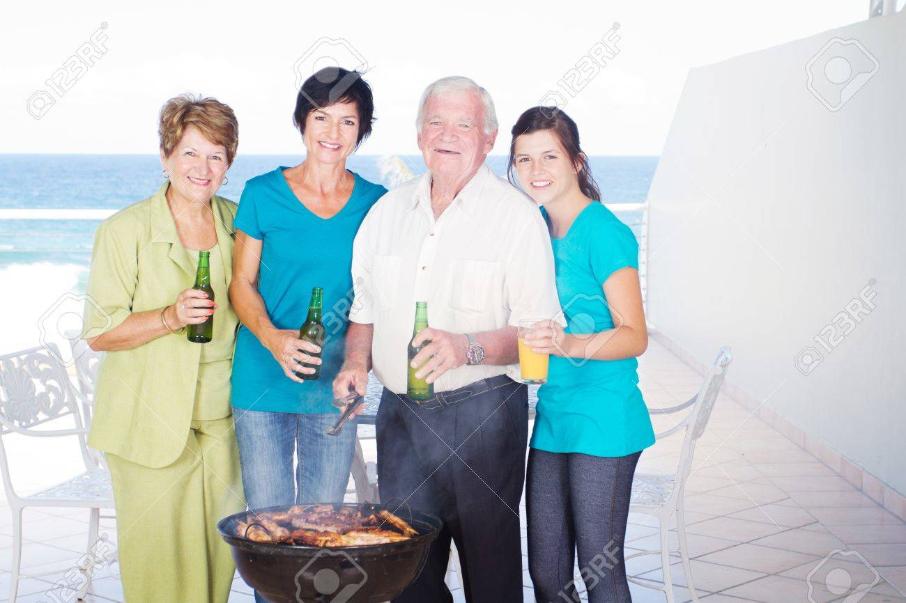 family barbeque on balcony with sea view background Stock Photo - 12728167