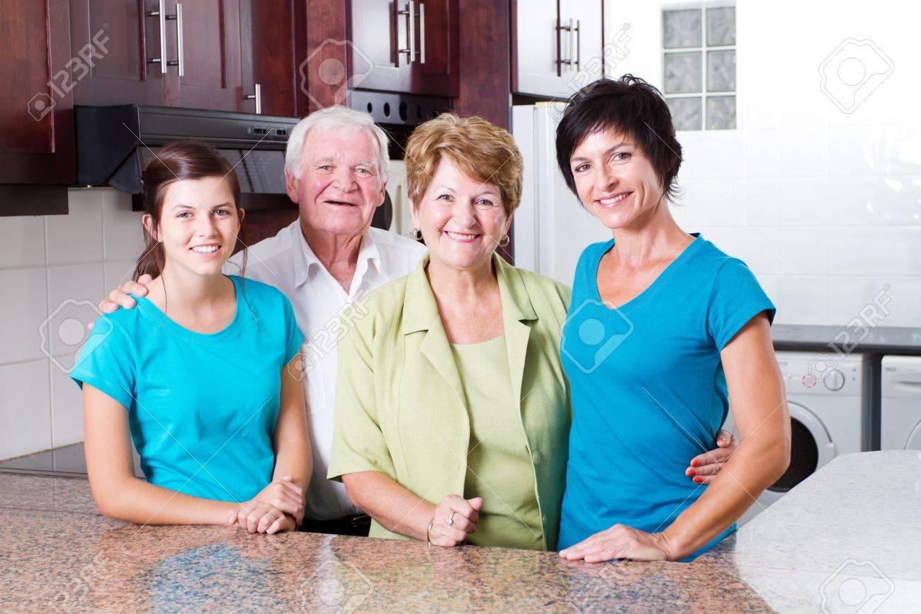 3 generation family portrait in kitchen Stock Photo - 12728494