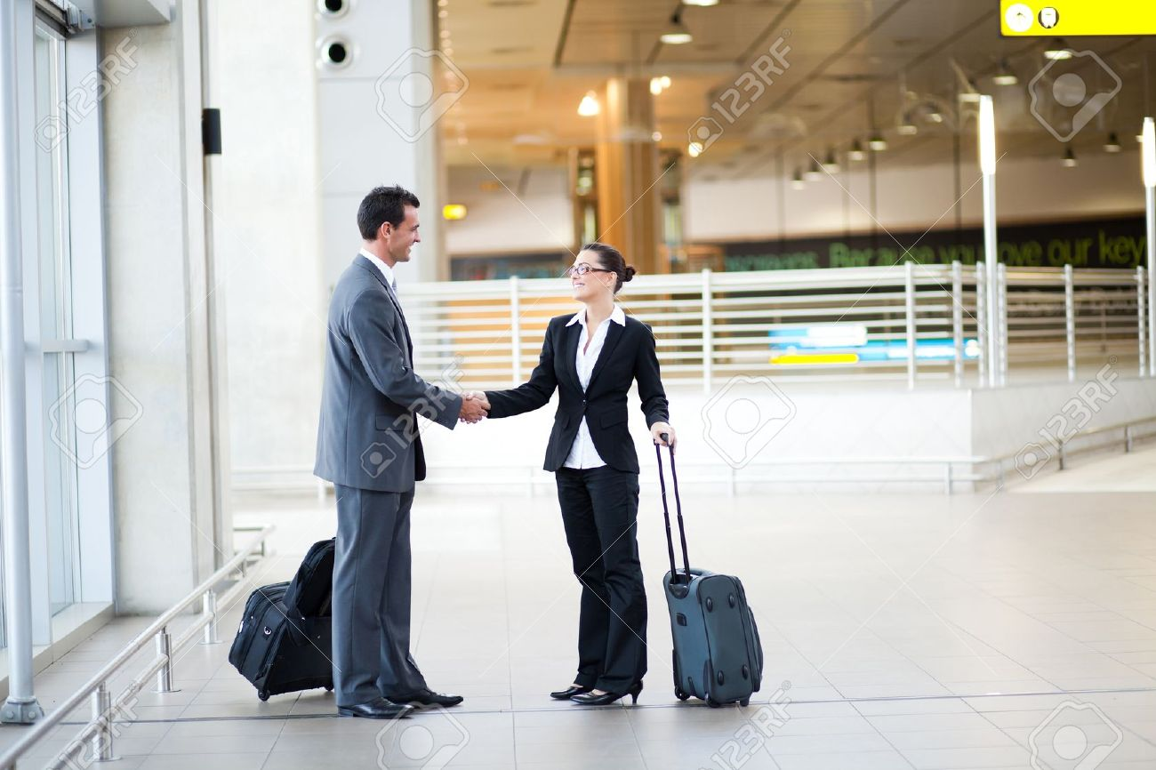 young businessman and businesswoman meeting at airport Stock Photo - 12897857
