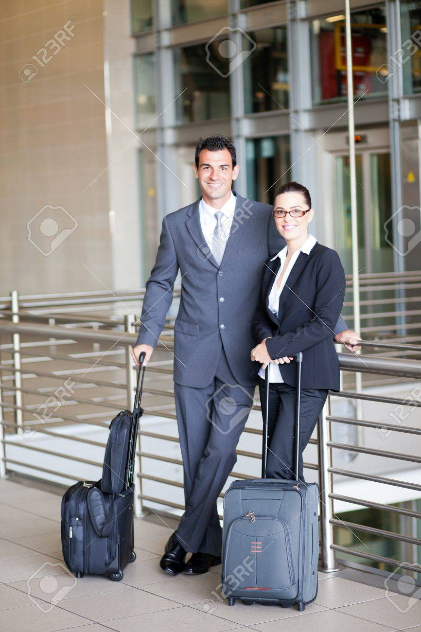 two young business travellers at airport Stock Photo - 12897842