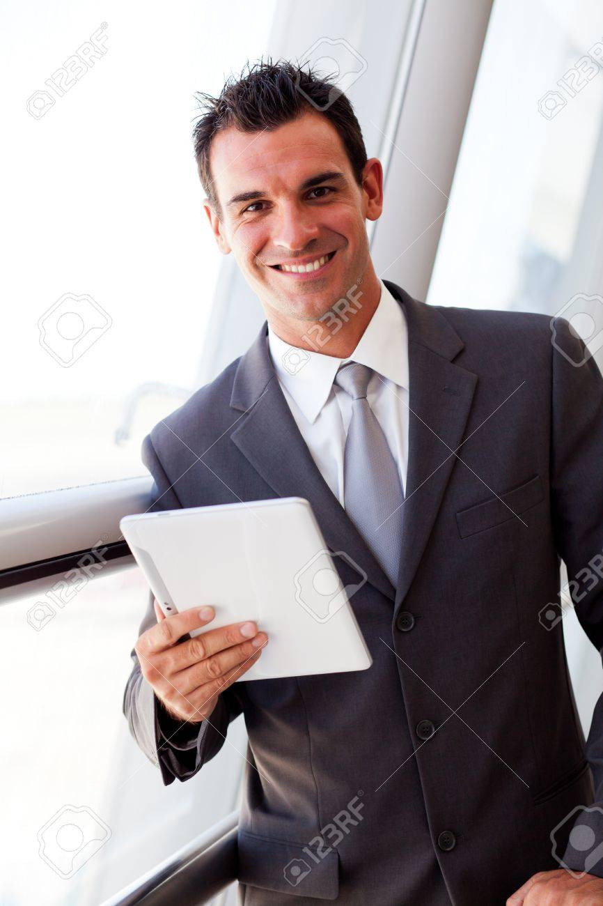 handsome young businessman using tablet computer Stock Photo - 12897887