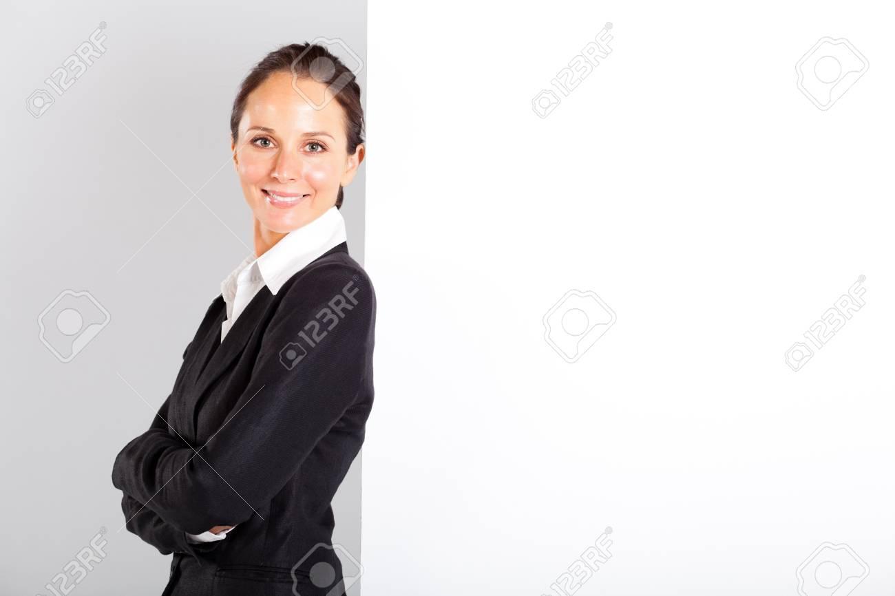 businesswoman standing next to white board Stock Photo - 13239038