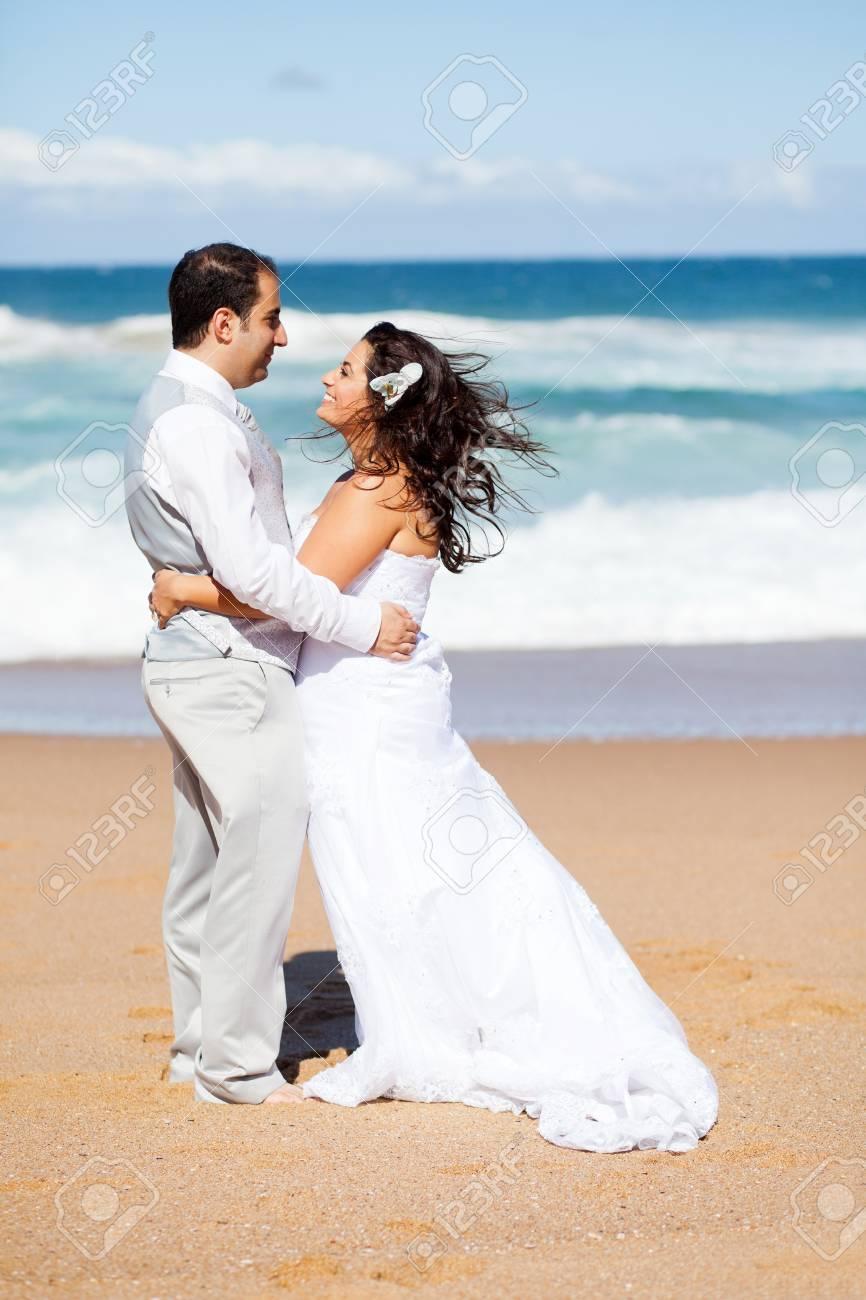 happy groom and bride hugging on beach Stock Photo - 13737205