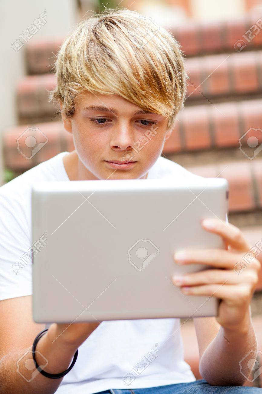 teenboy Stock Photo - teen boy using tablet computer outdoors