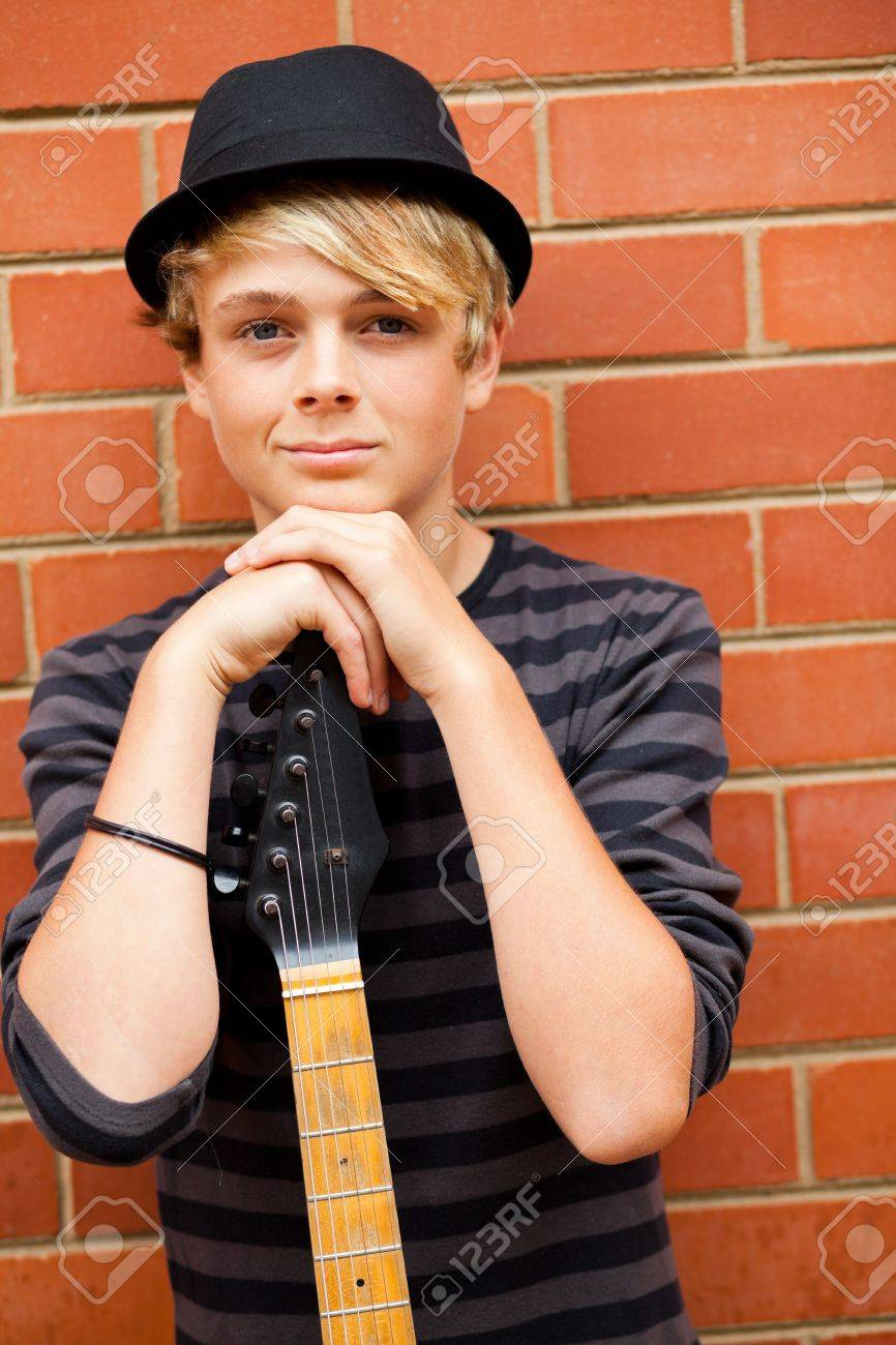 handsome teen musician portrait with guitar Stock Photo - 13738539