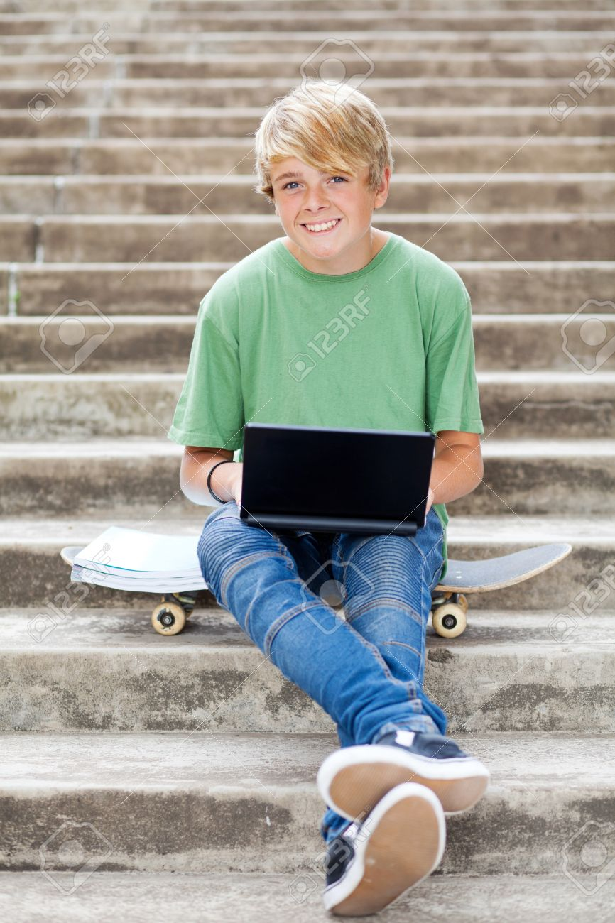teenboy cute teen boy with laptop outdoors Stock Photo - 13737601