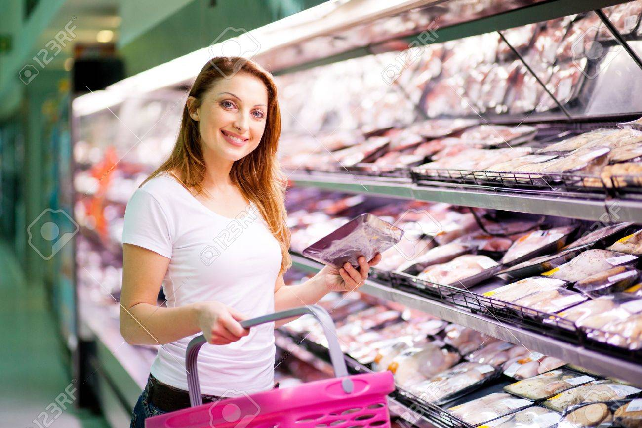 young woman shopping in supermarket Stock Photo - 13954393