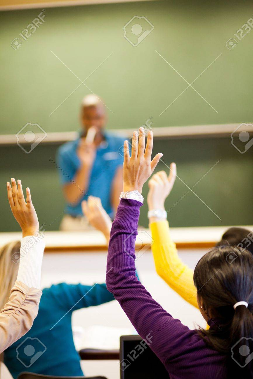 group of students arms up in classroom Stock Photo - 14669224