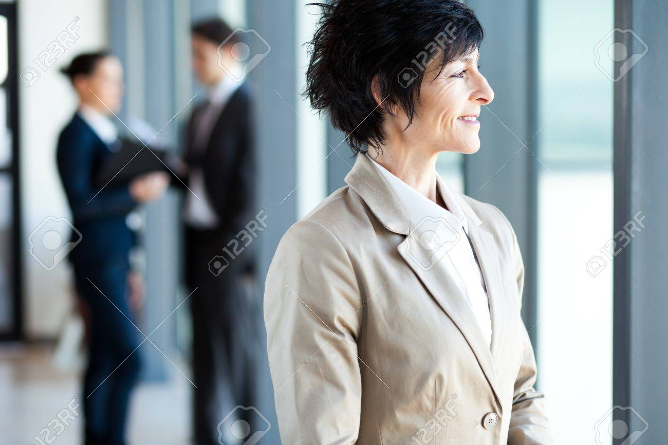mature businesswoman looking outside office window Stock Photo - 14899054