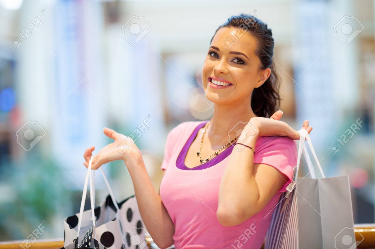 happy young woman carring shopping bags in mall Stock Photo - 15401578