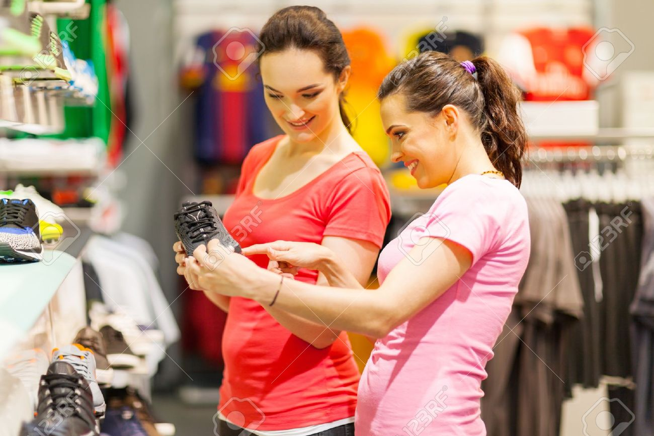 a3e3ad4c09c young women shopping for sports shoes