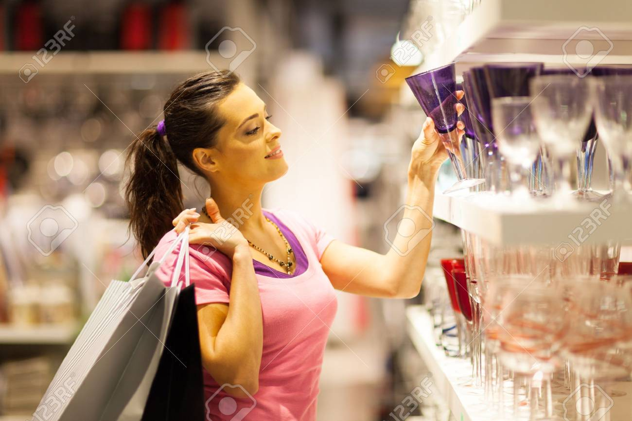young woman shopping for glass Stock Photo - 15402612