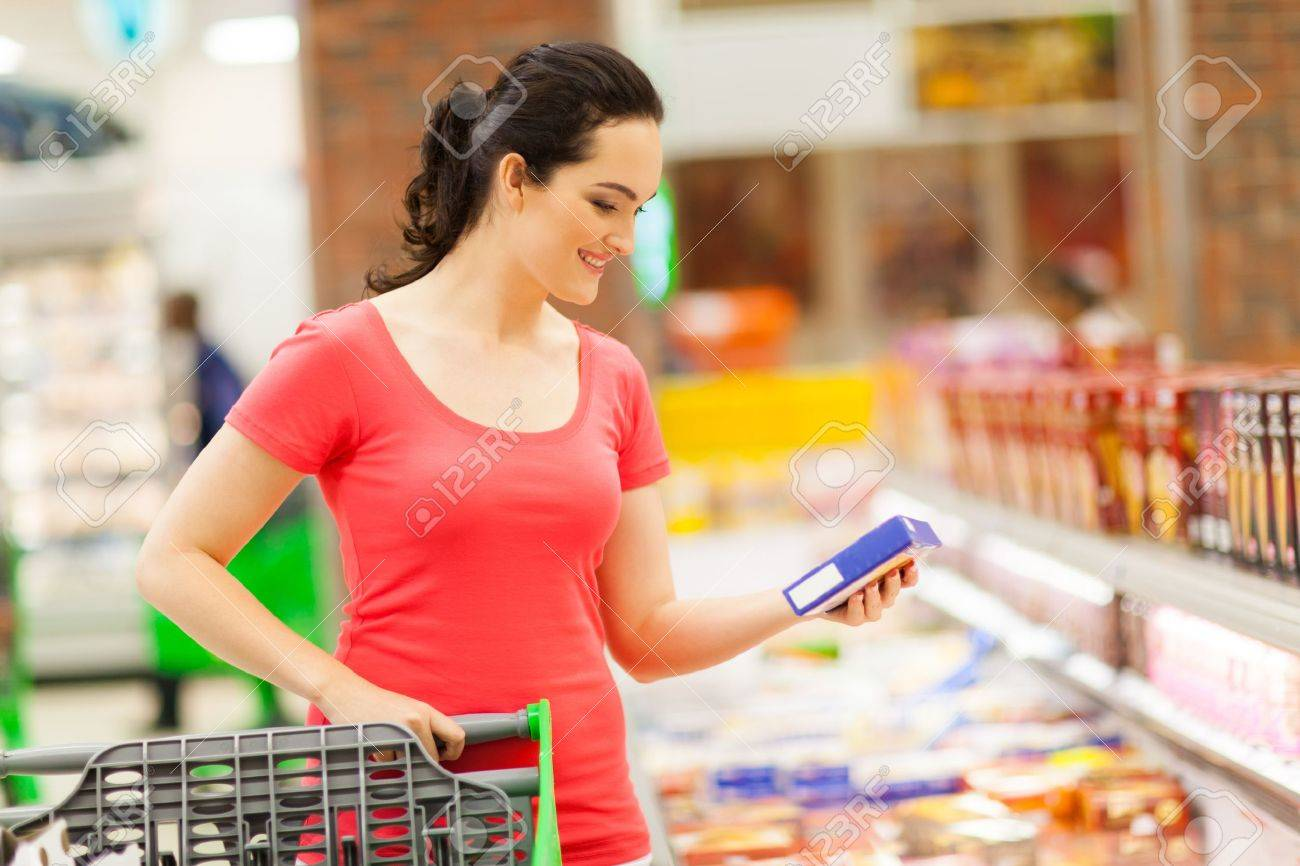 young woman doing grocery shopping in supermarket Stock Photo - 15402541