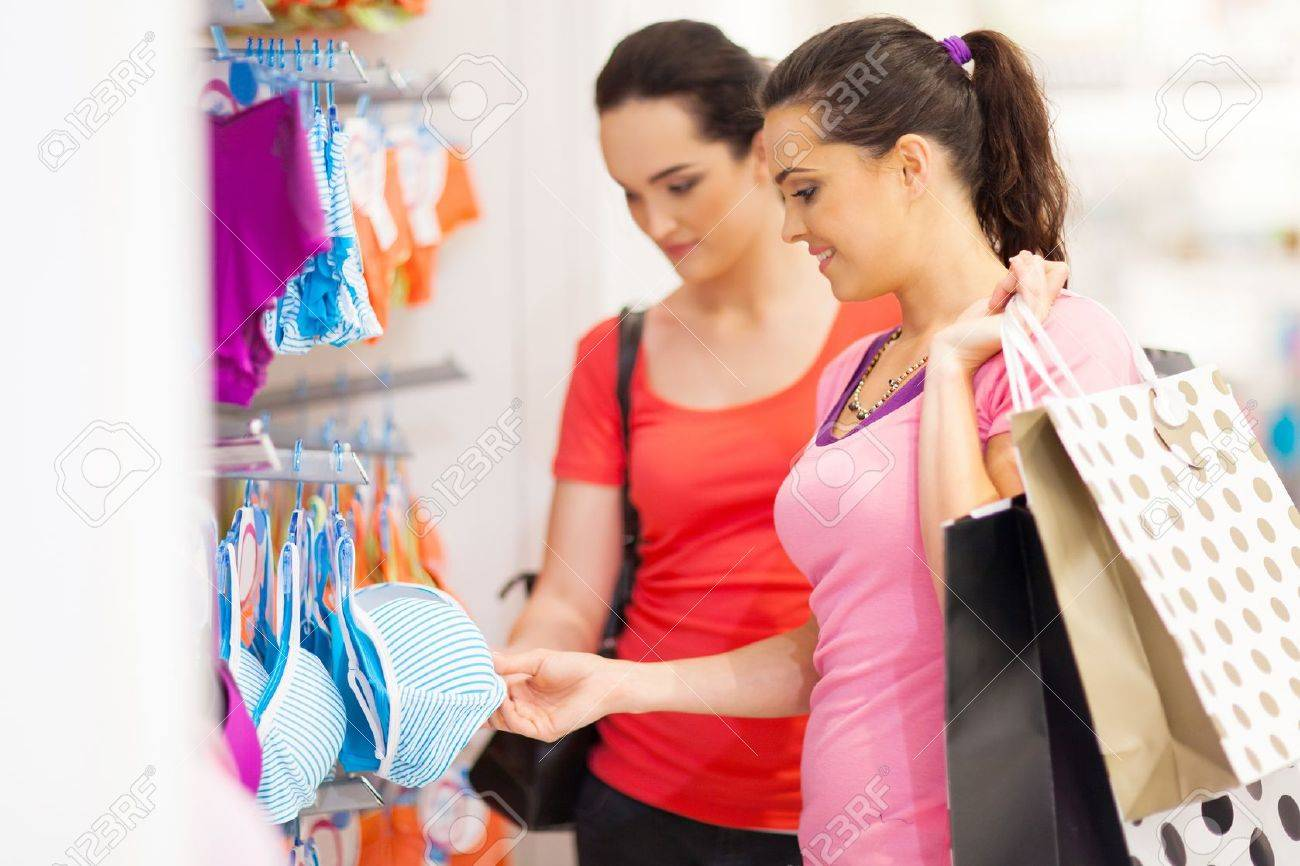 Two Young Woman Shopping For Lingerie In Clothing Store Stock ...