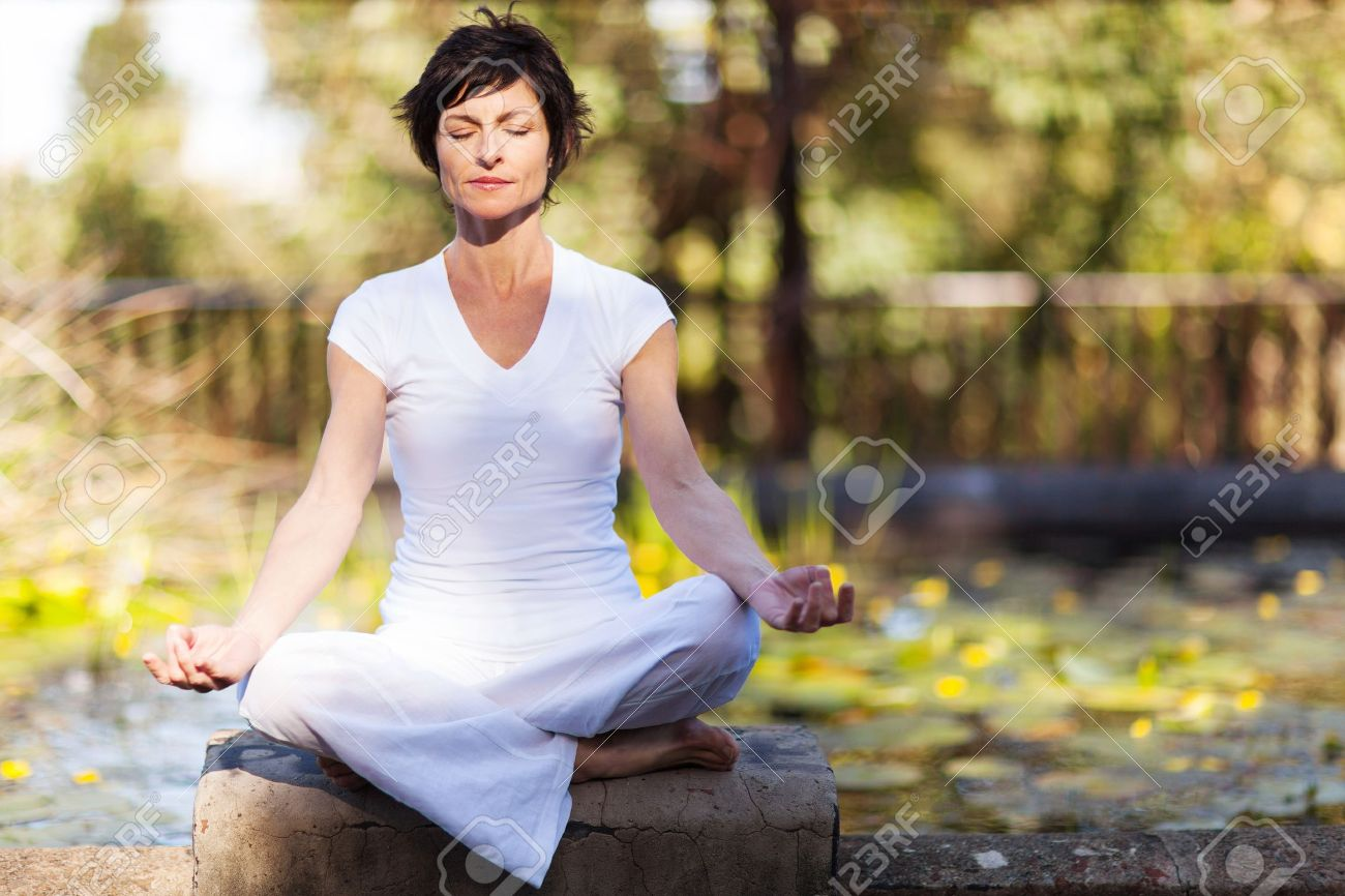 middle aged woman doing yoga meditation outdoors Stock Photo - 15557676