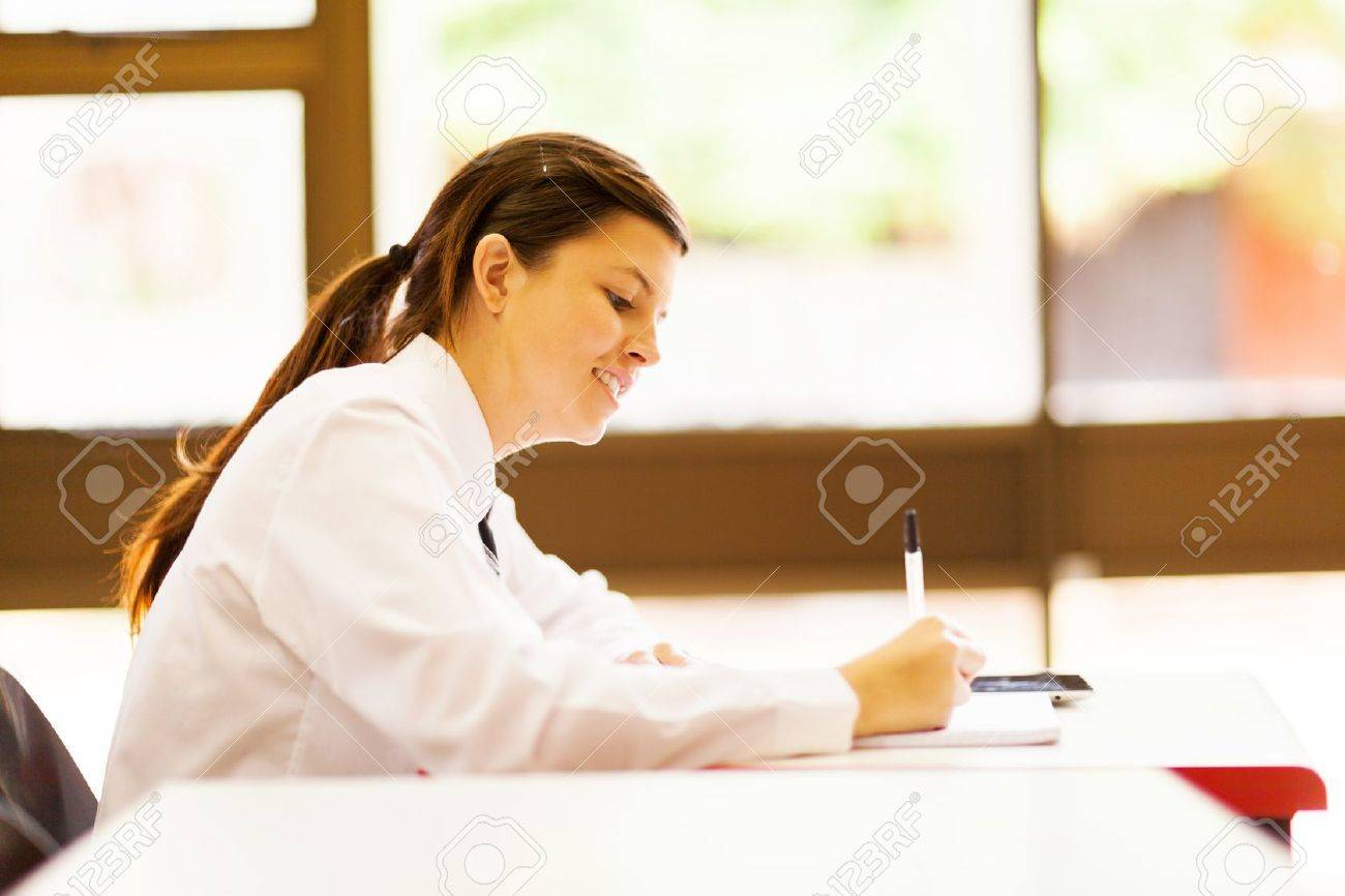 cute high school girl studying in classroom Stock Photo - 15893411