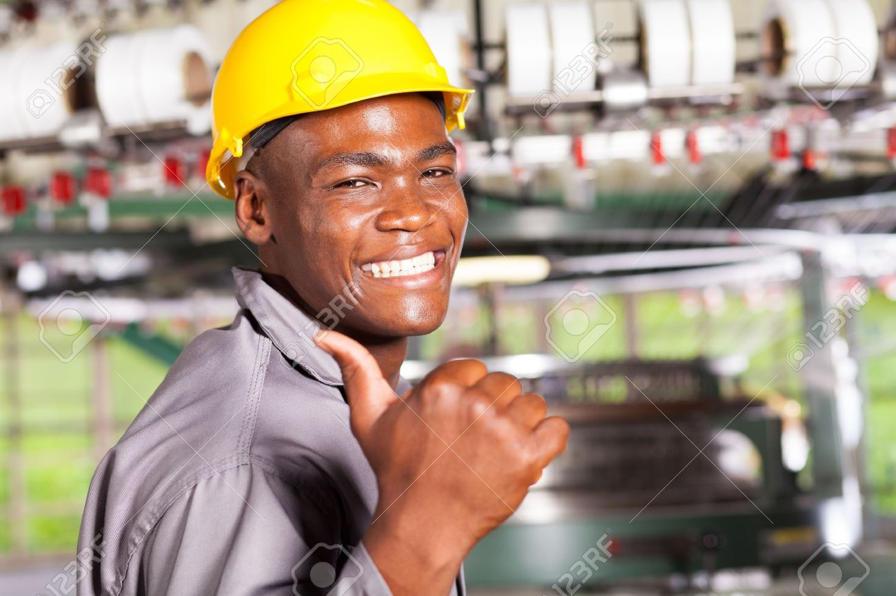 happy african american textile worker thumb up in factory Stock Photo - 16013905