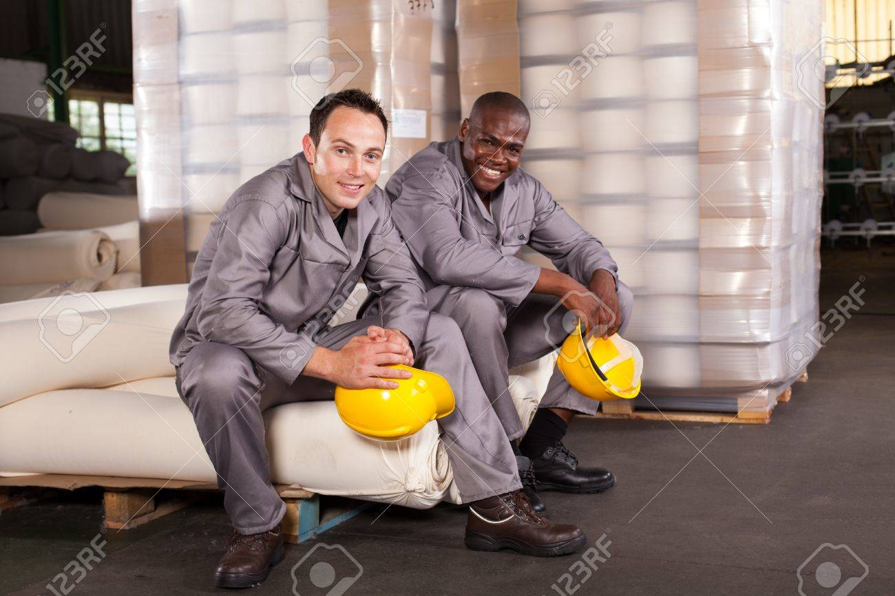 two textile factory workers relaxing during break Stock Photo - 16013865