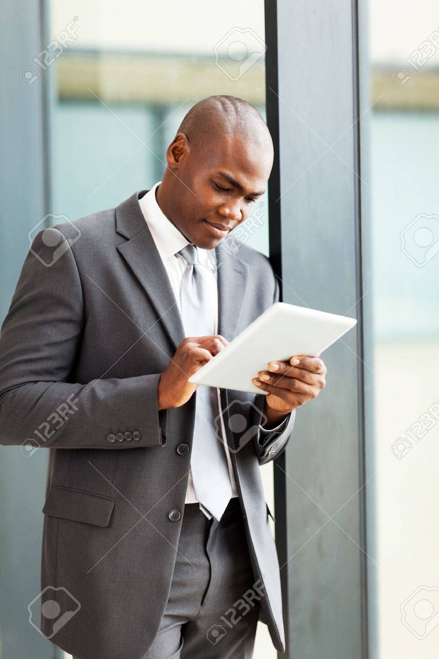 thoughtful african american businessman with tablet computer in office Stock Photo - 16013872