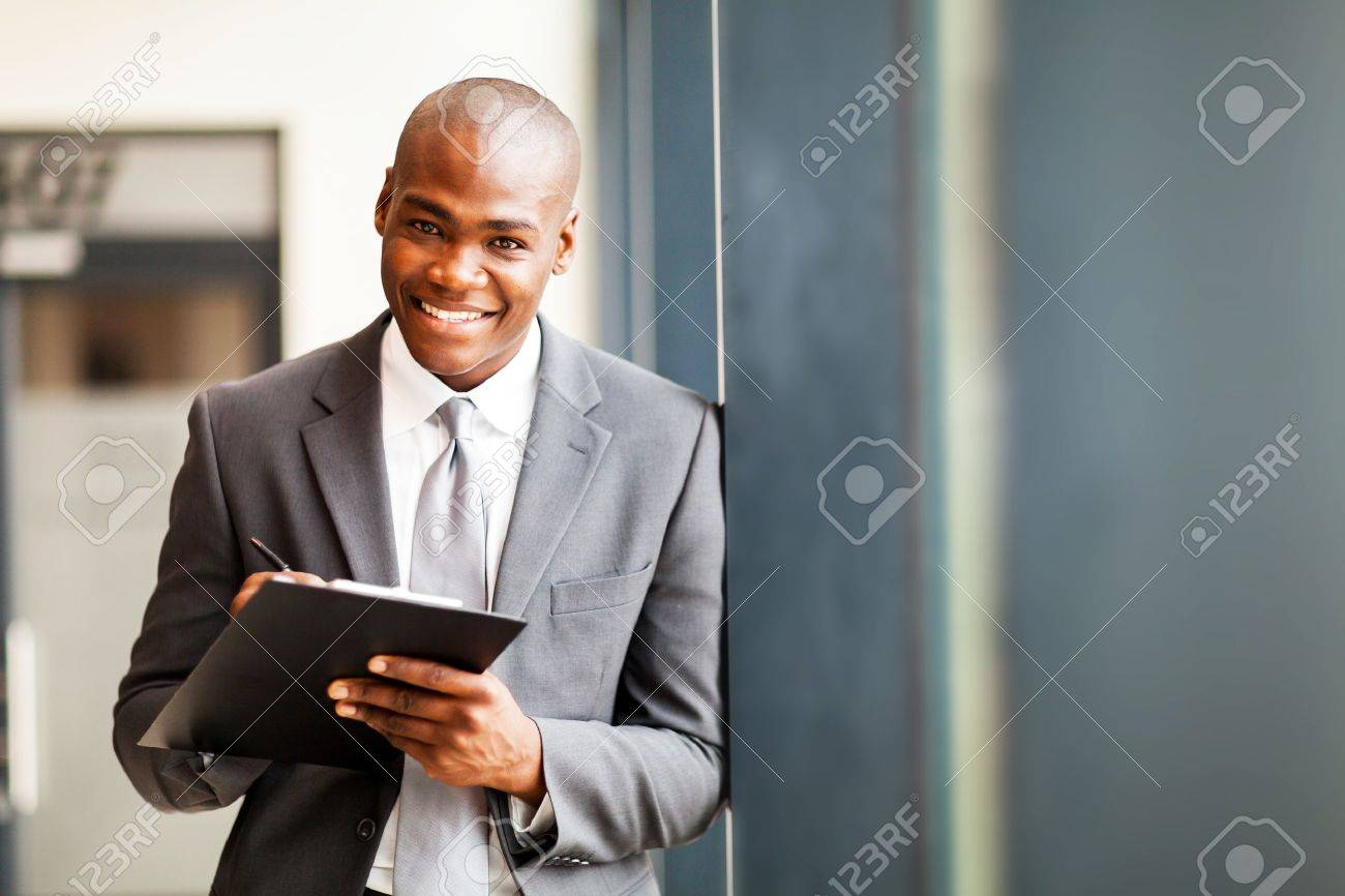 african american businessman writing report in office Stock Photo - 16013850