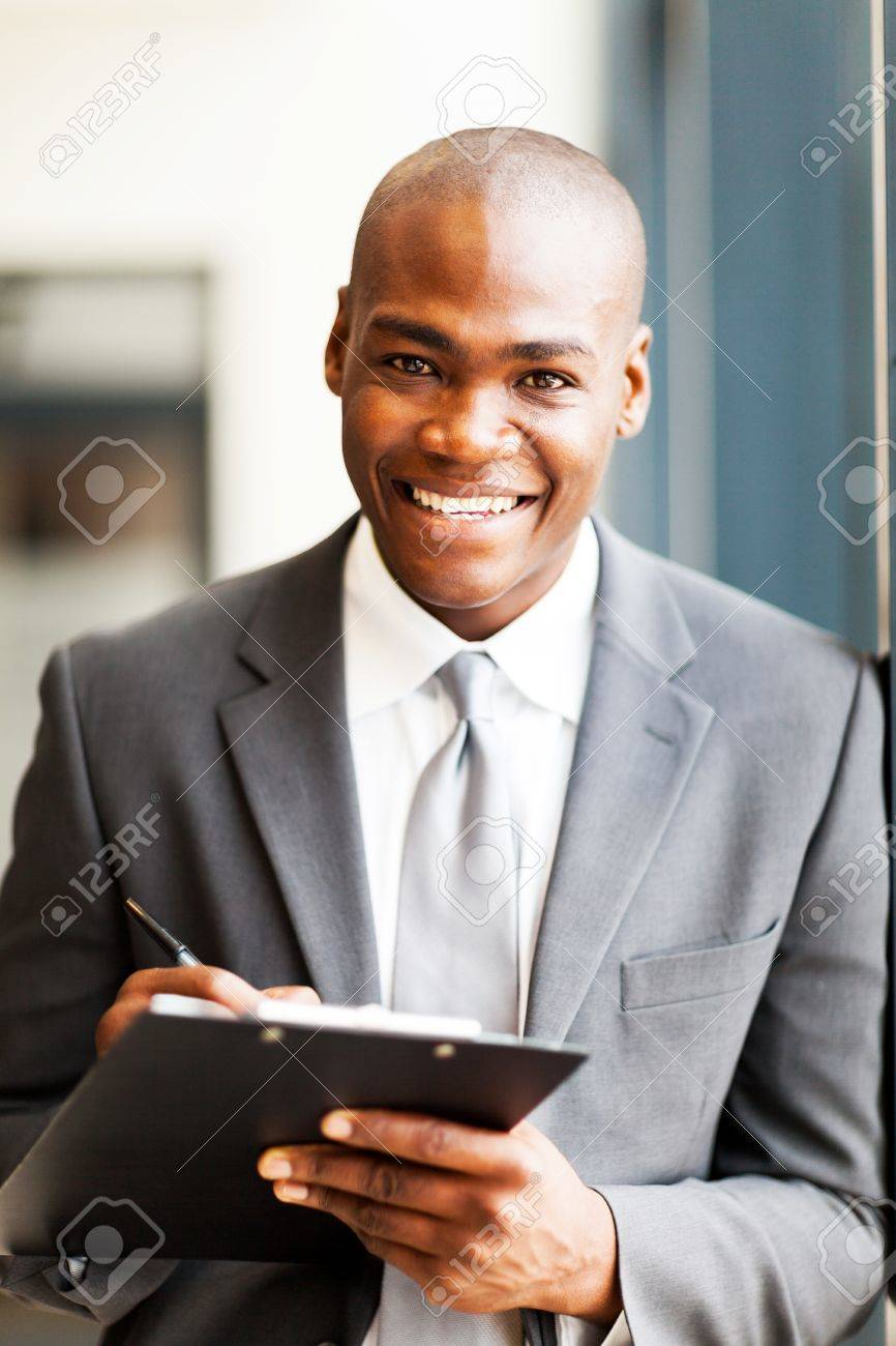 smiling african american office worker writing report in office Stock Photo - 16013911