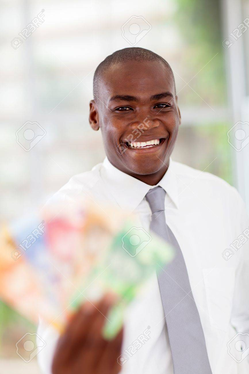 happy young african businessman with cash notes Stock Photo - 16825069