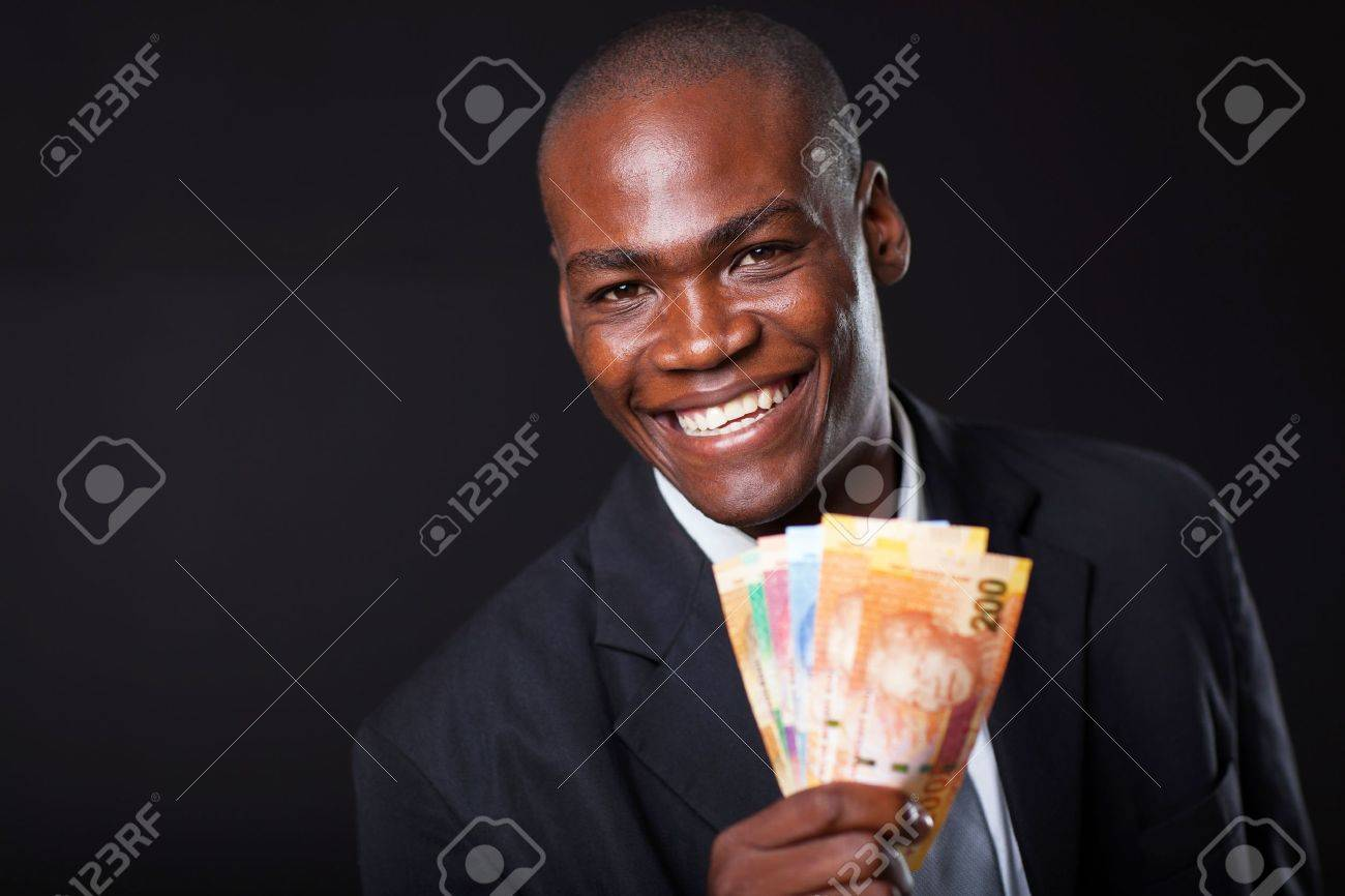 happy african businessman with south african cash notes Stock Photo - 16825049