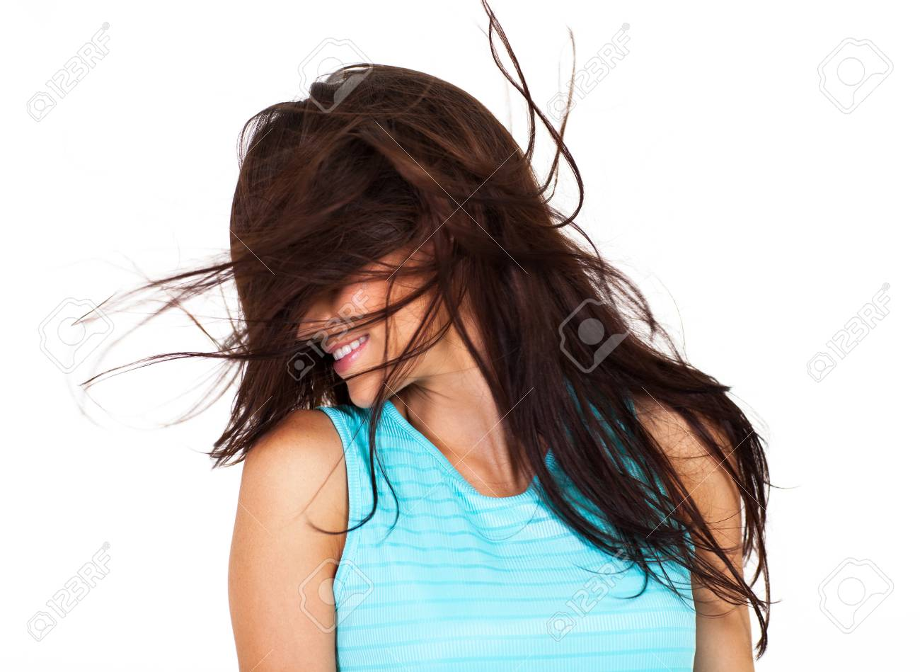 young woman having fun with messy hair isolated on white Stock Photo - 17232789
