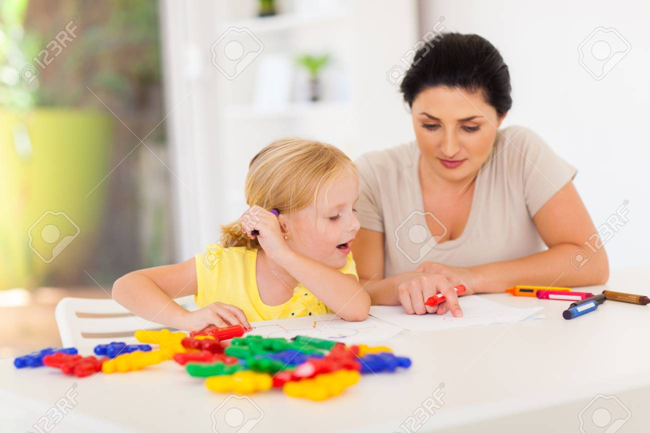 mother teaching little daughter drawing at home Stock Photo - 17331627