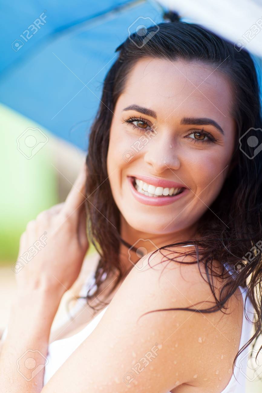 bd199e2a012 pretty woman having fun in the rain Stock Photo - 17388050