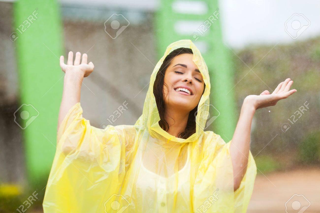9f5598d587d pretty young woman enjoying the rain outdoors Stock Photo - 17388219