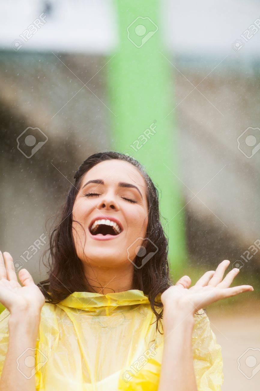 e1de7bd6aa7 young woman having fun in the rain Stock Photo - 17388205