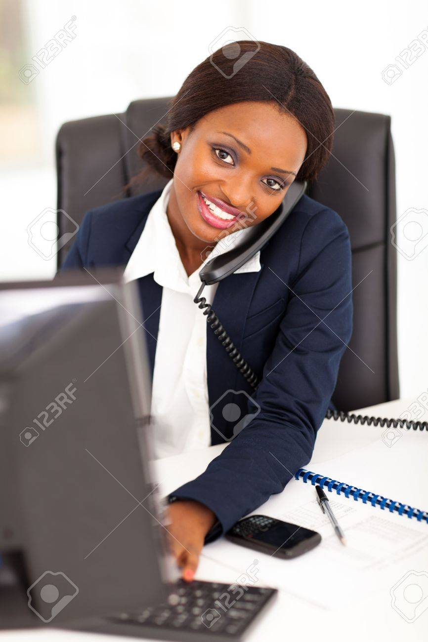 pretty female african corporate worker working in office Stock Photo - 17457161