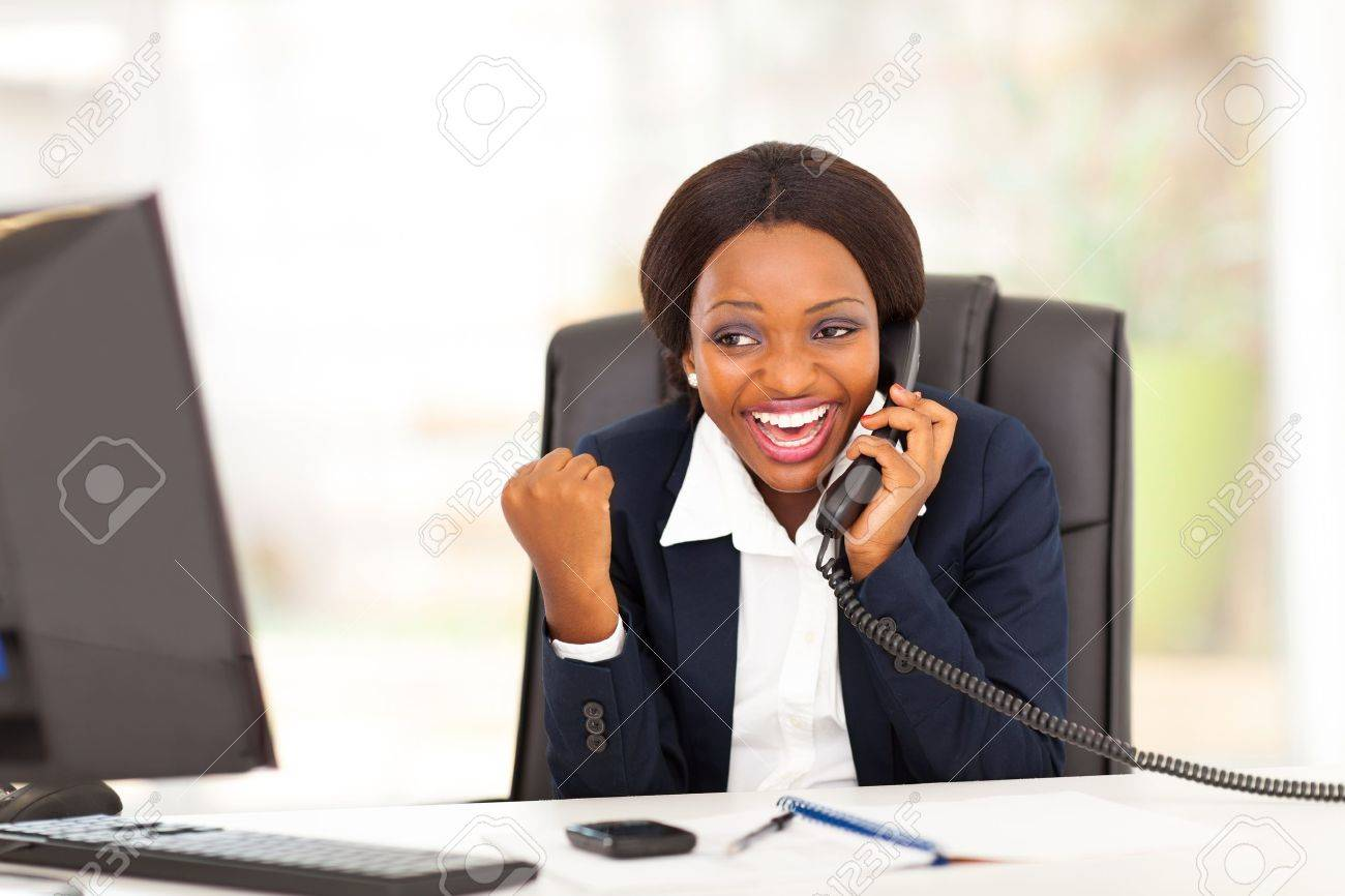young african american businesswoman receiving excited news in office Stock Photo - 17457286