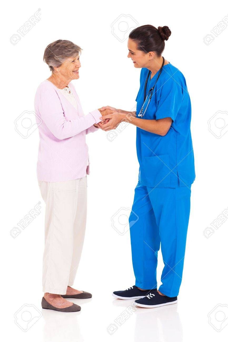 young female medical worker greeting senior woman isolated on white Stock Photo - 17591202