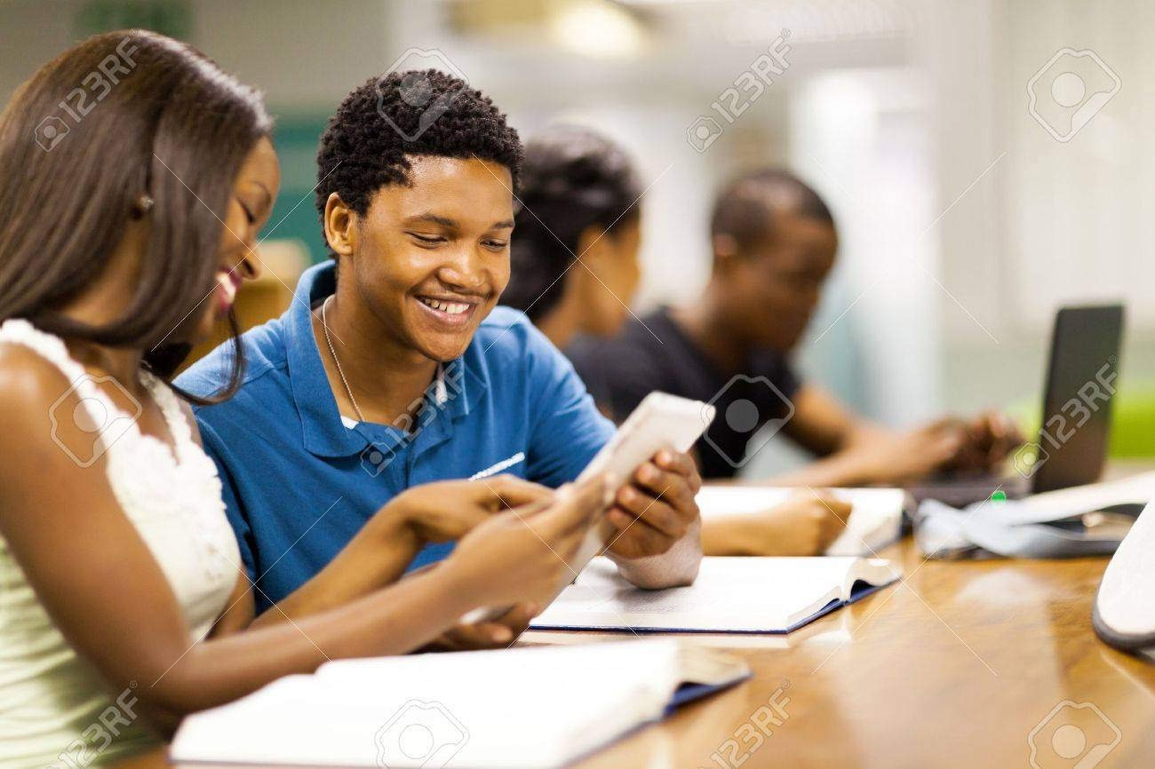 happy african college students using tablet computer together Stock Photo - 17718222