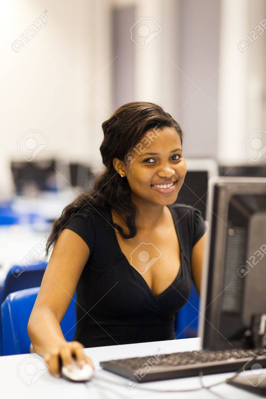 pretty female african american university student in computer room Stock Photo - 17718206