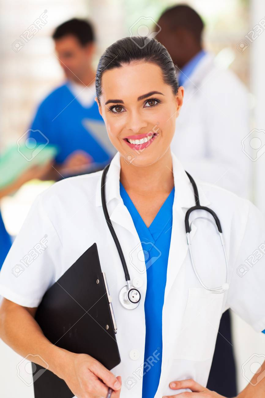 pretty female medical worker in front of colleagues Stock Photo - 17781840