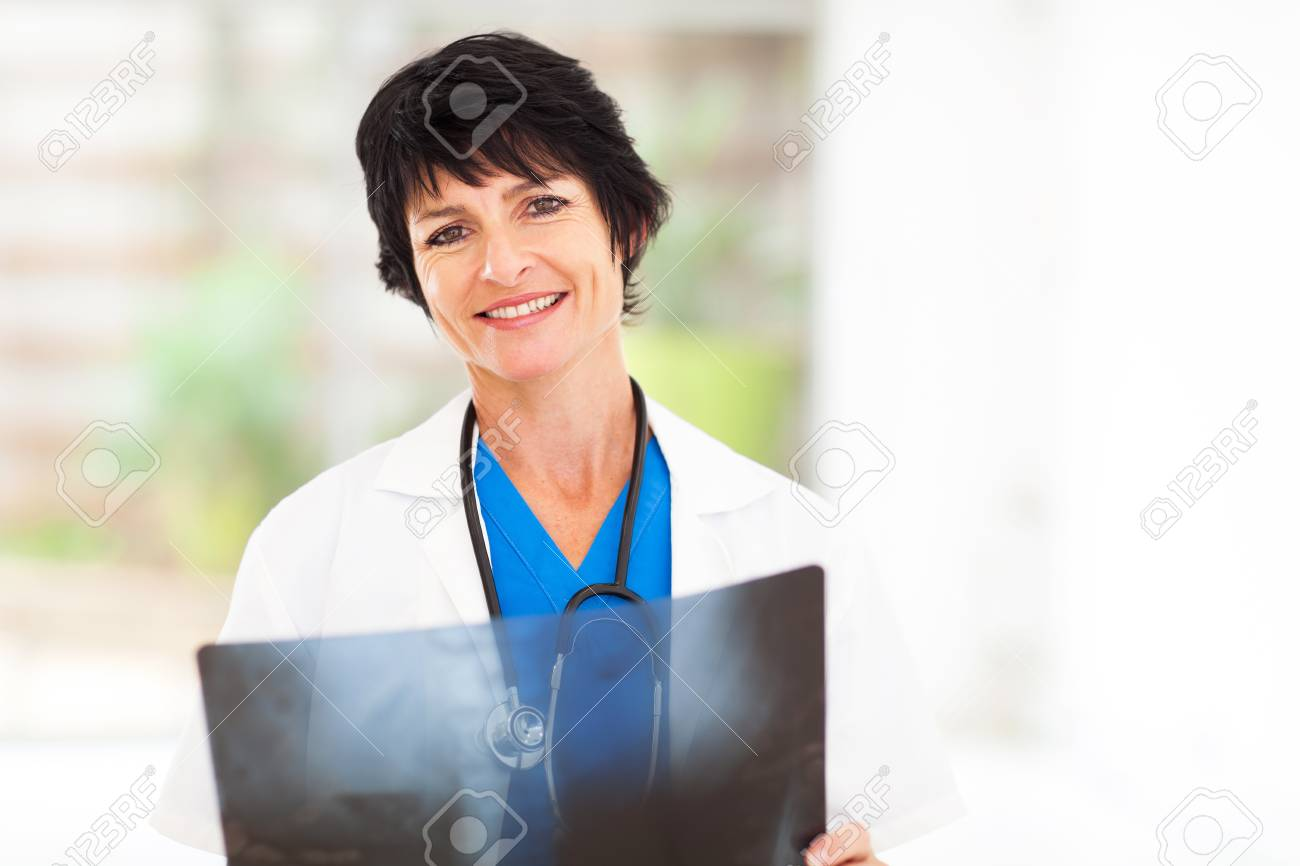 mature female medical doctor with x ray stock photo, picture and