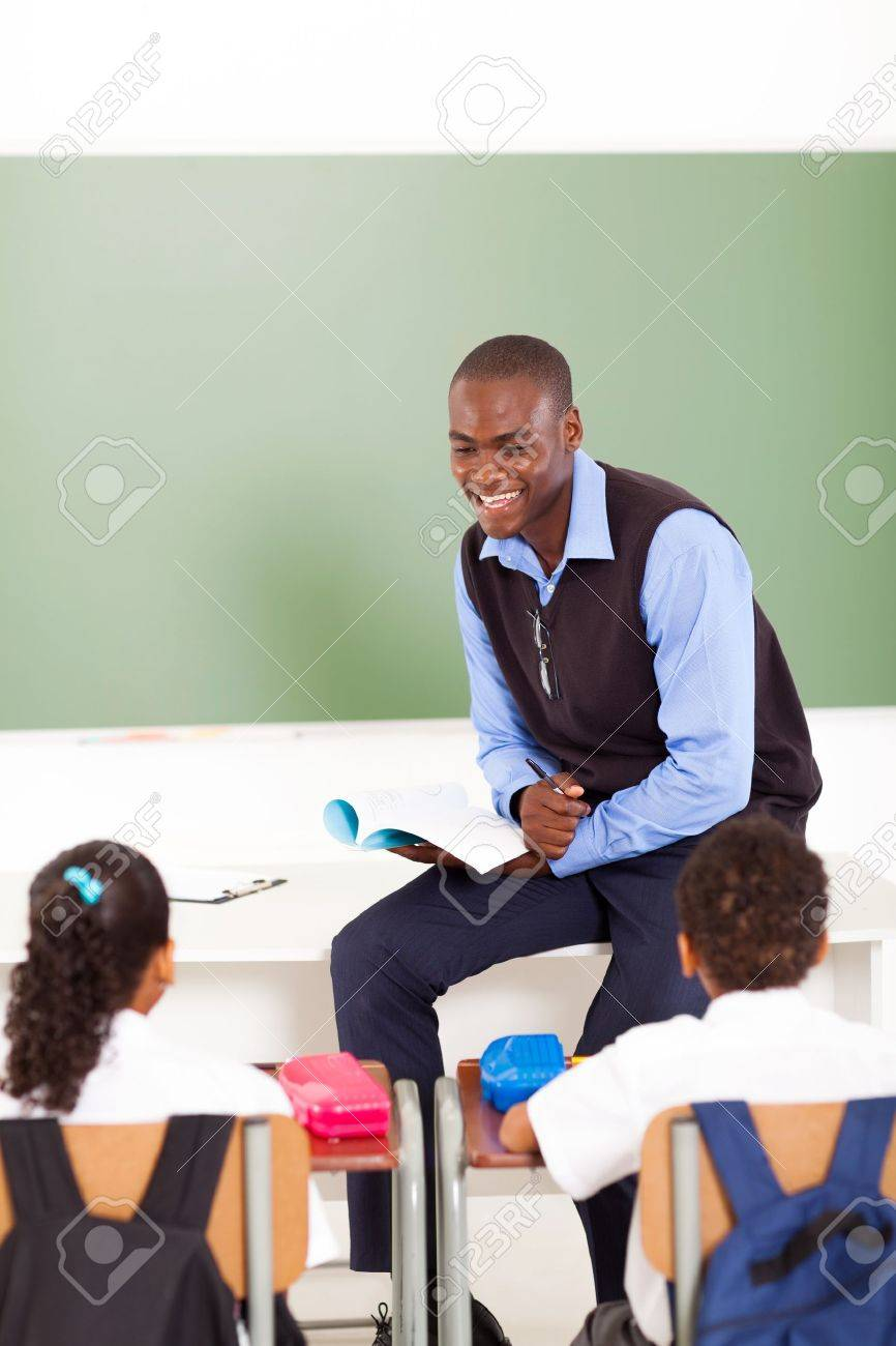 male african primary school teacher teaching in classroom stock photo 18075582