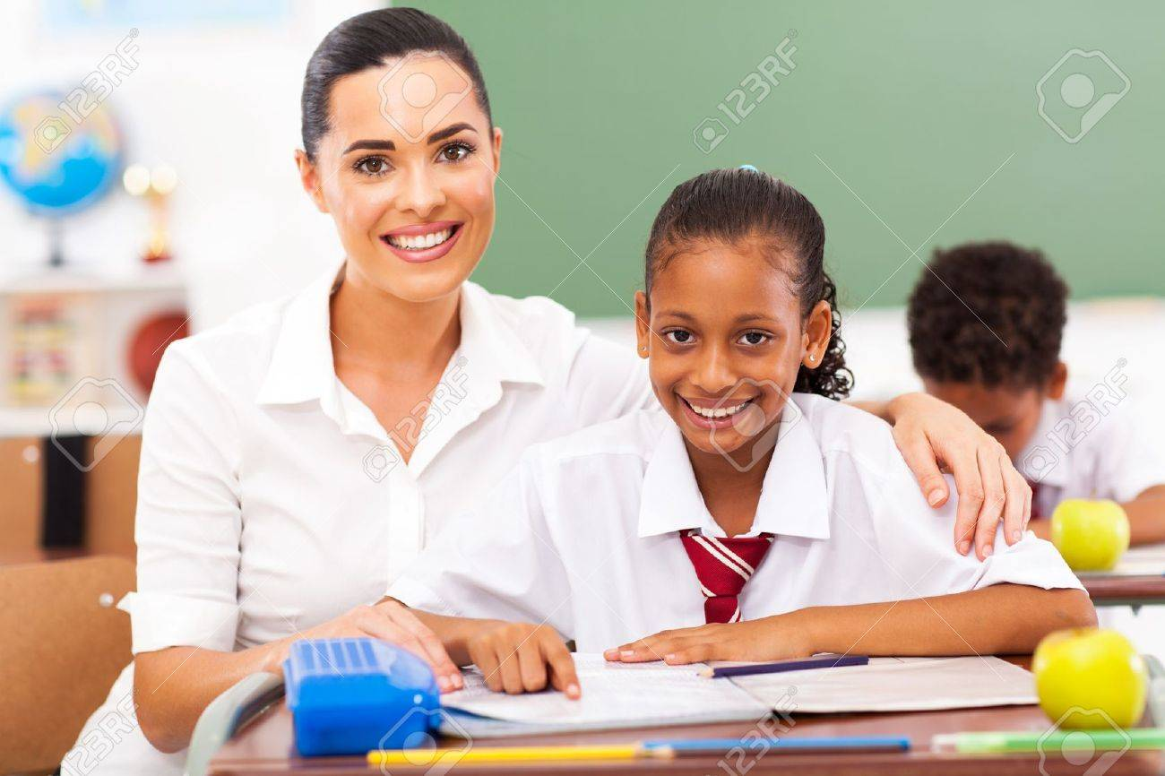 beautiful primary school teacher and students in classroom stock photo 18075618