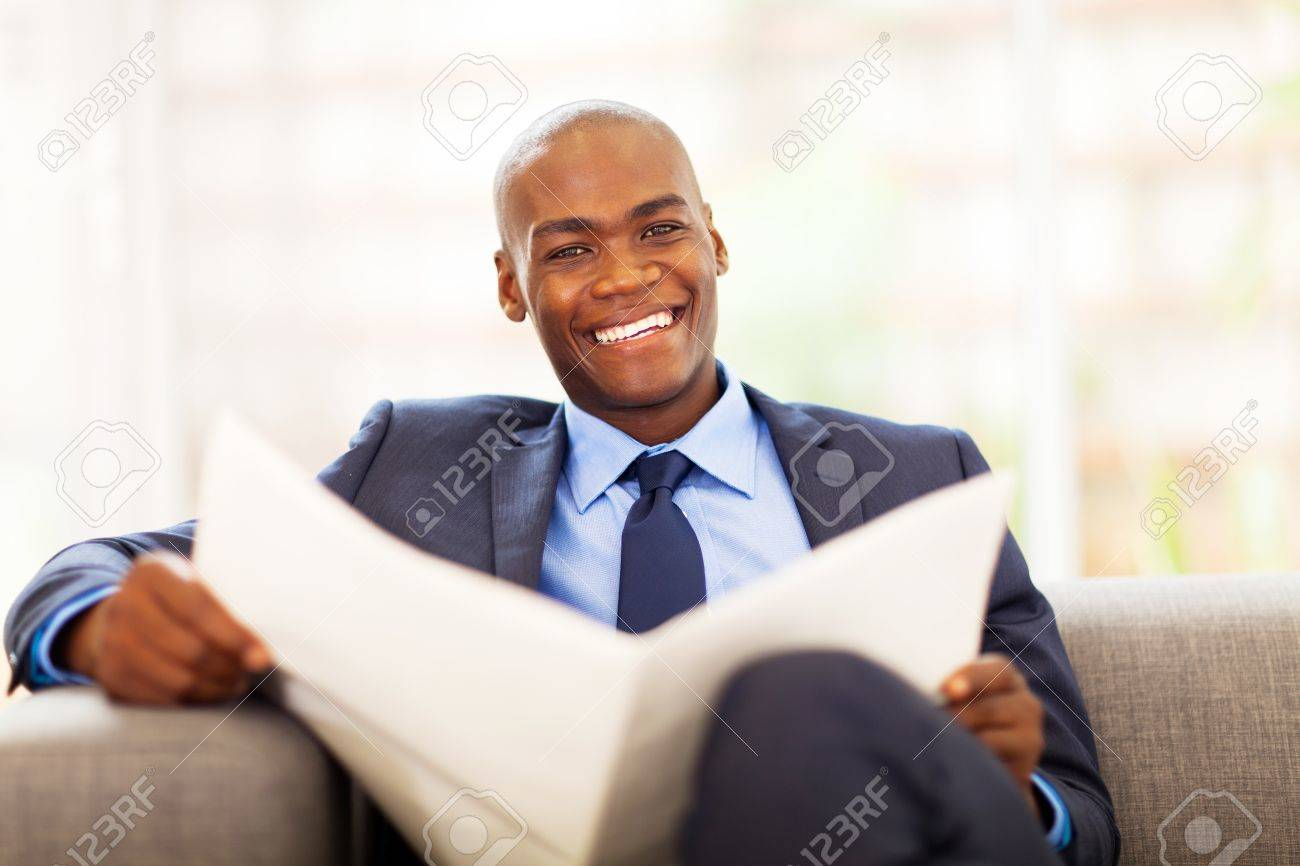 african american businessman reading newspaper on sofa Stock Photo - 18208747