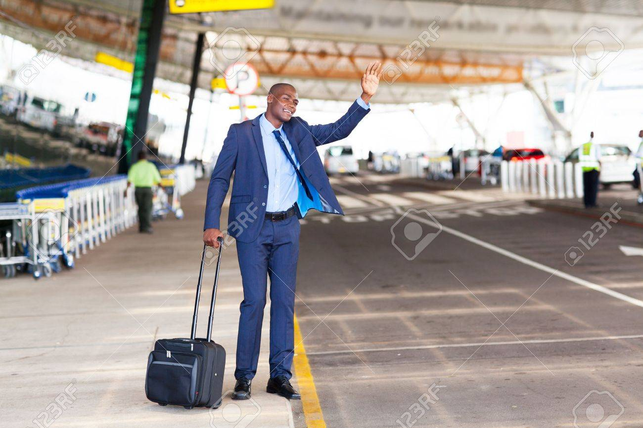 african american businessman calling taxi in airport - 18270658
