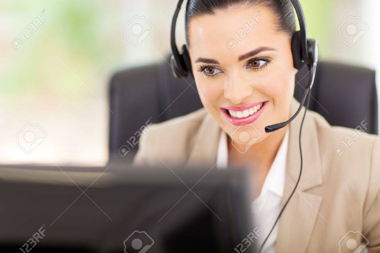 pretty female support center operator with headset Stock Photo - 18983663