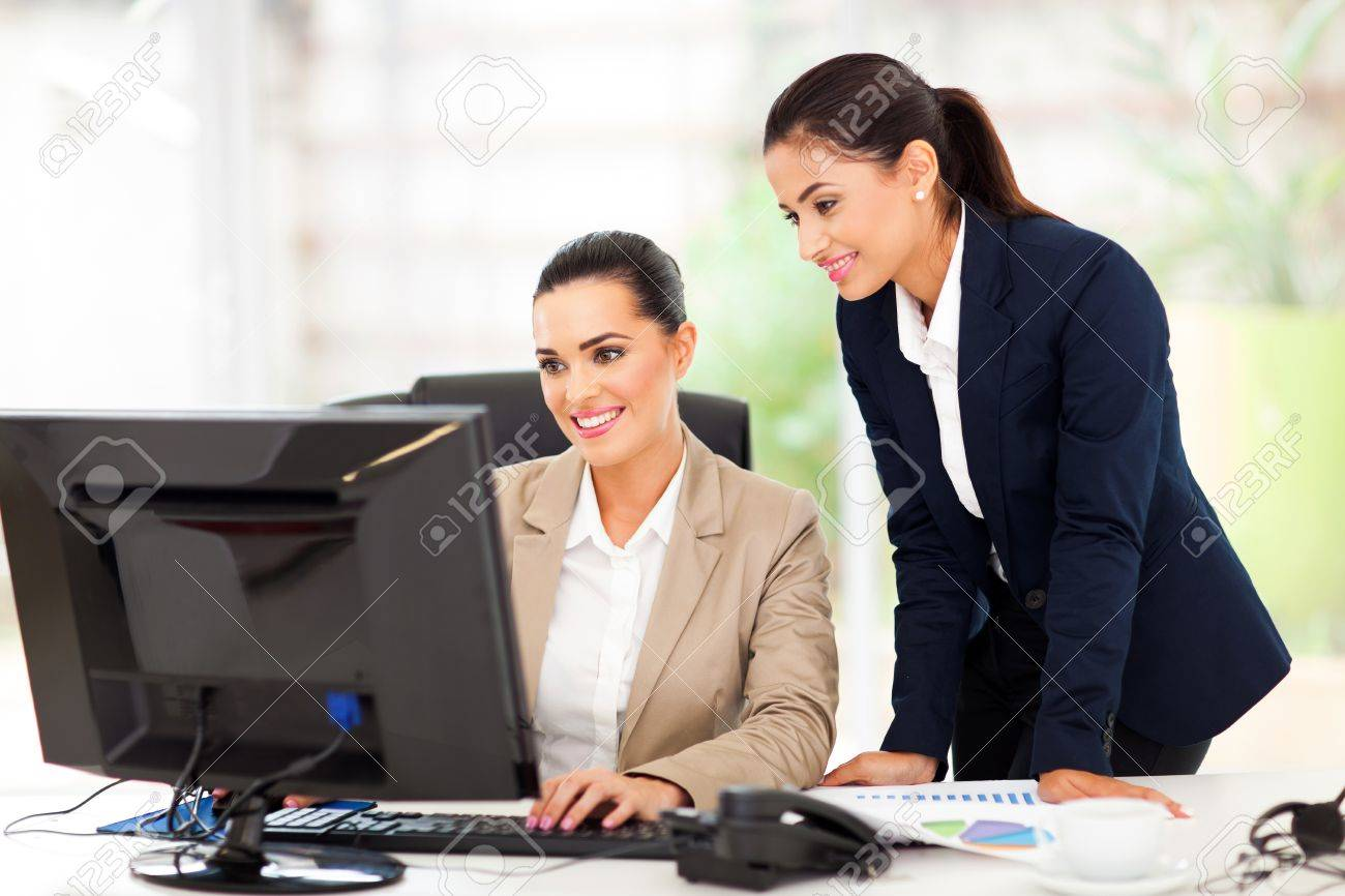 attractive business women working using computer Stock Photo - 18983646