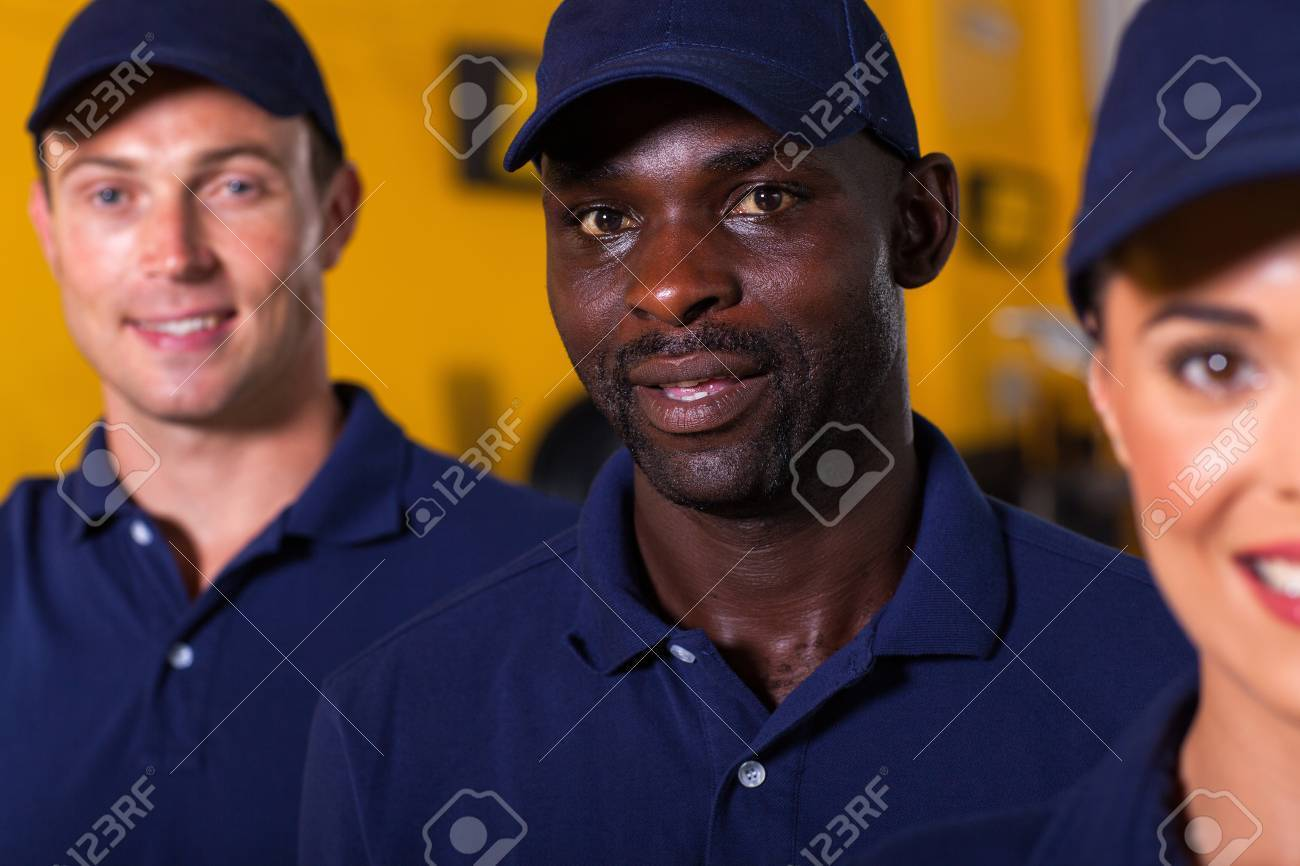 close up portrait of afro american auto technician with colleagues Stock Photo - 19202534