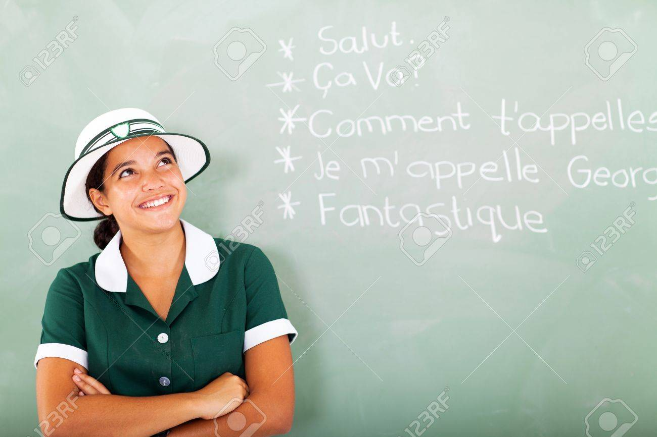 Cheerful Female High School Student Learning French In Classroom