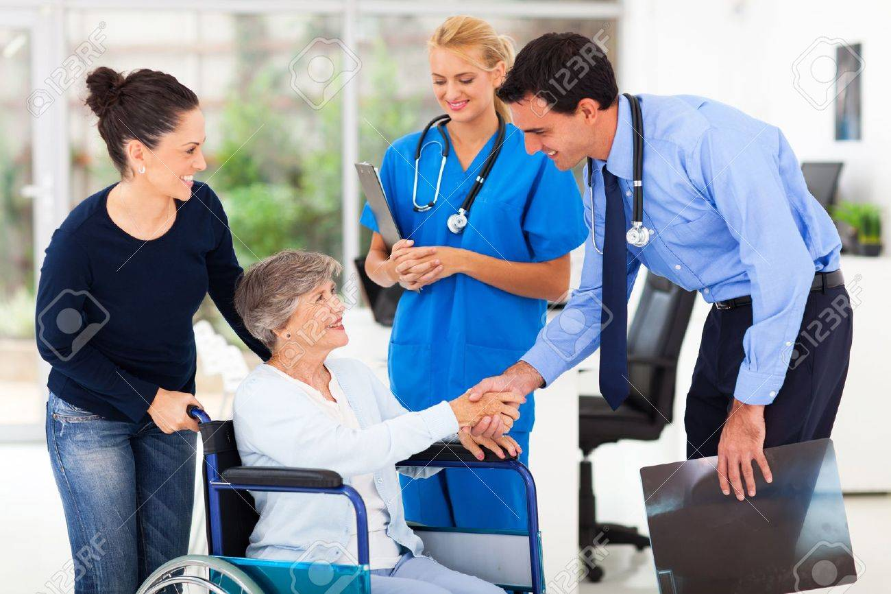 friendly male medical doctor greeting senior patient Stock Photo - 19411564
